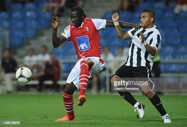 Danny Simpson of Newcastle United competes with Eder of SC Braga during a preSeason friendly match between Newcastle United and SC Braga on July 28...