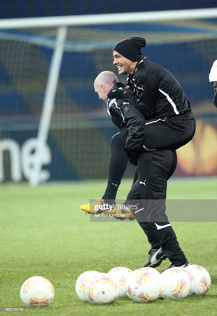 Danny Simpson of Newcastle United FC piggy backs on coach Steve Stone during a training session ahead of their UEFA Europa League round of 32 second leg match against FC Metalist Kharkiv, at Metalist Stadium, on February 20, 2013 in Kharkov, Ukraine.