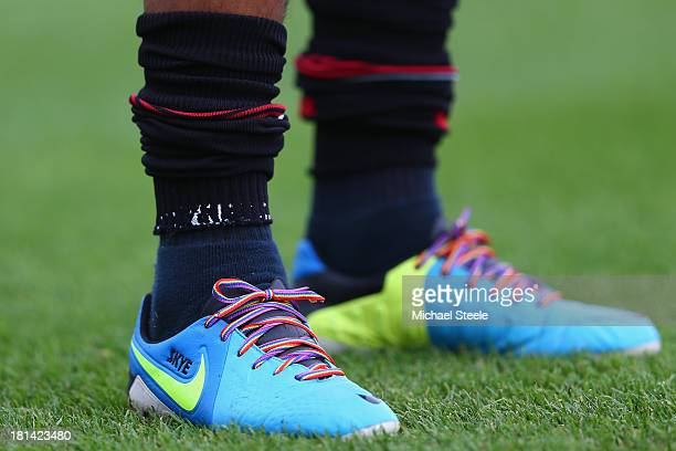 Danny Simpson of Queens Park Rangers sports the Rainbow boot laces during warm up ahead of the Sky Bet Championship match between Yeovil Town and...