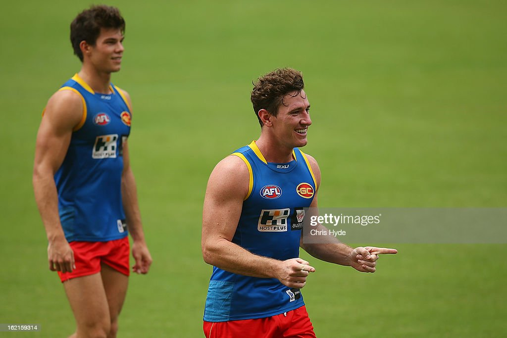 Danny Stanley celebrates a goal while Jaeger O'Meara looks on during a Gold Coast Suns AFL training session at Metricon Stadium on February 20, 2013 in Gold Coast, Australia.