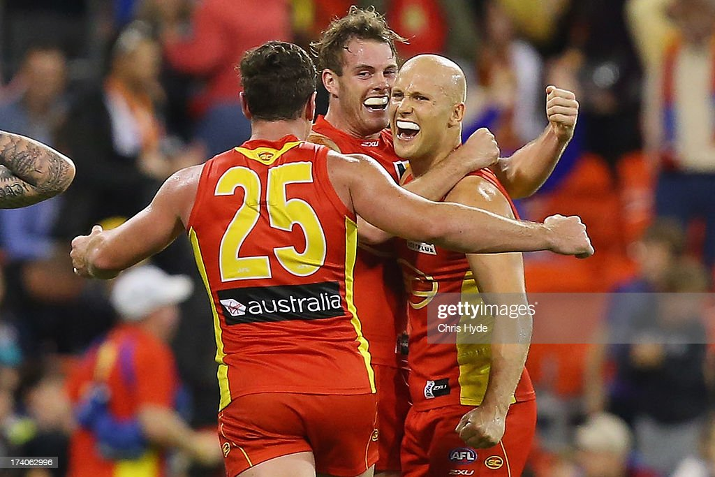 Danny Stanley, Luke Russell and <a gi-track='captionPersonalityLinkClicked' href=/galleries/search?phrase=Gary+Ablett&family=editorial&specificpeople=206196 ng-click='$event.stopPropagation()'>Gary Ablett</a> of the Suns celebrate winning the round 17 AFL match between the Gold Coast Suns and the Collingwood Magpies at Metricon Stadium on July 20, 2013 in Gold Coast, Australia.