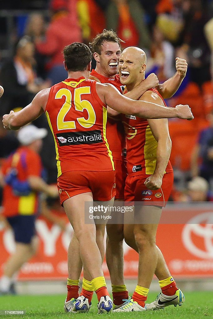 Danny Stanley, Luke Russell and Gary Ablett of the Suns celebrate winning the round 17 AFL match between the Gold Coast Suns and the Collingwood Magpies at Metricon Stadium on July 20, 2013 in Gold Coast, Australia.