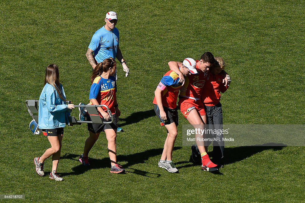 Danny Stanley of the Suns leaves the field injured during the NEAFL match between the Gold Coast Suns and the Southport Sharks at Metricon Stadium on July 2, 2016 in Gold Coast, Australia.