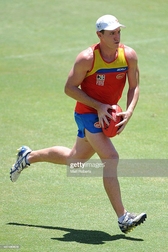 Danny Stanley runs with the ball during a Gold Coast Suns AFL pre-season training session at Metricon Stadium on December 18, 2013 on the Gold Coast, Australia.