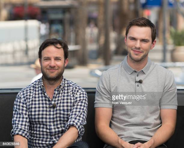 Danny Strong and Nicolas Hoult visit 'Extra' at Universal Studios Hollywood on August 29 2017 in Universal City California