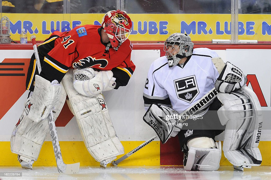 Danny Taylor #41 of the Calgary Flames and <a gi-track='captionPersonalityLinkClicked' href=/galleries/search?phrase=Jonathan+Quick&family=editorial&specificpeople=2271852 ng-click='$event.stopPropagation()'>Jonathan Quick</a> #32 of the Los Angeles Kings talk during warm-ups before an NHL game at Scotiabank Saddledome on February 20, 2013 in Calgary, Alberta, Canada.