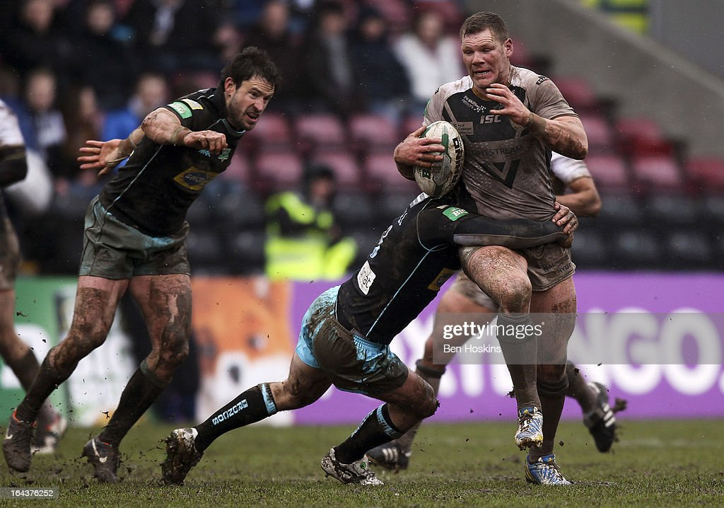 Danny Tickle of Hull is tackled by <a gi-track='captionPersonalityLinkClicked' href=/galleries/search?phrase=Antonio+Kaufusi&family=editorial&specificpeople=546208 ng-click='$event.stopPropagation()'>Antonio Kaufusi</a> of the London Broncos during the Super League match between London Broncos and Hull at Twickenham Stoop on March 23, 2013 in London, England.