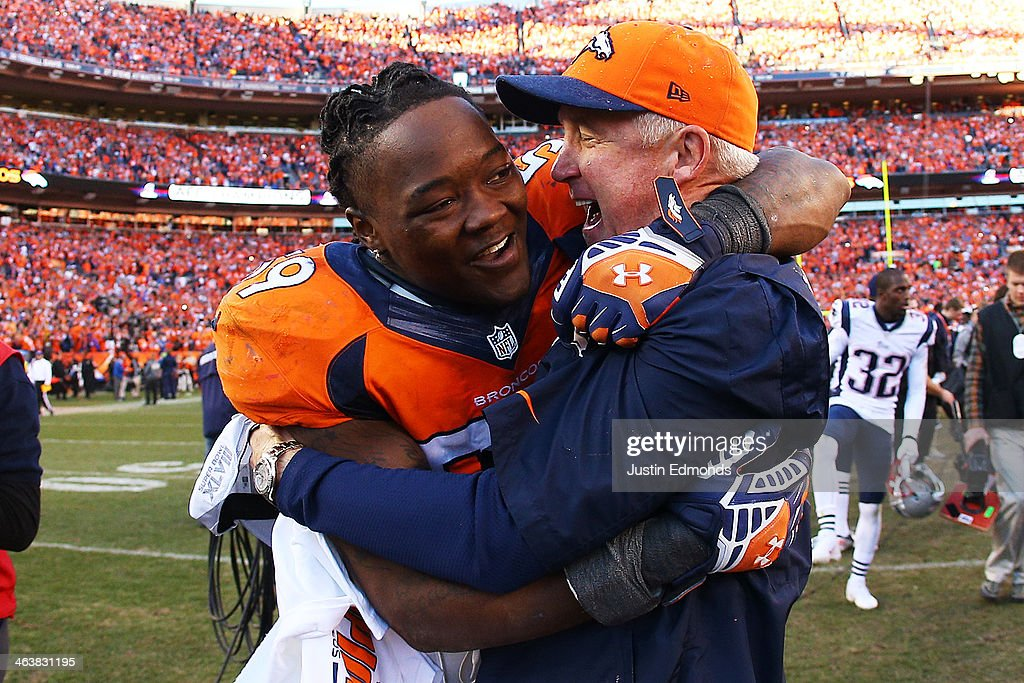 <a gi-track='captionPersonalityLinkClicked' href=/galleries/search?phrase=Danny+Trevathan&family=editorial&specificpeople=6475347 ng-click='$event.stopPropagation()'>Danny Trevathan</a> #59 of the Denver Broncos celebrates with head coach <a gi-track='captionPersonalityLinkClicked' href=/galleries/search?phrase=John+Fox+-+Trainer&family=editorial&specificpeople=206657 ng-click='$event.stopPropagation()'>John Fox</a> of the Denver Broncos after they defeated the New England Patriots 26 to 16 during the AFC Championship game at Sports Authority Field at Mile High on January 19, 2014 in Denver, Colorado.