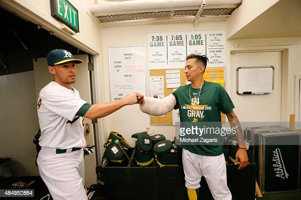 Danny Valencia and Jesse Chavez of the Oakland Athletics celebrate in the clubhouse following the game against the Houston Astros at Oco Coliseum on...
