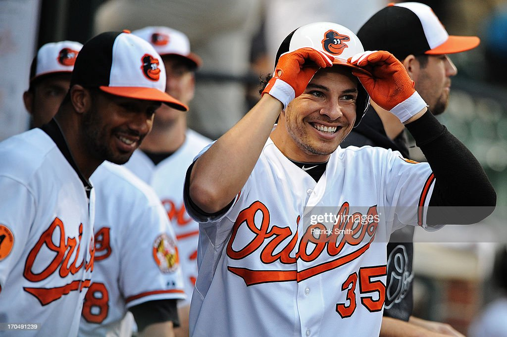 <a gi-track='captionPersonalityLinkClicked' href=/galleries/search?phrase=Danny+Valencia&family=editorial&specificpeople=5443820 ng-click='$event.stopPropagation()'>Danny Valencia</a> #35 of the Baltimore Orioles celebrates with teammates after hitting a home run against the Boston Red Sox in the third inning at Oriole Park at Camden Yards on June 13, 2013 in Baltimore, Maryland.
