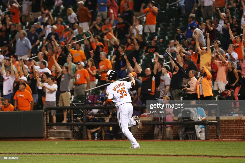 Danny Valencia #35 of the Baltimore Orioles follows his three RBI home run against the New York Yankees during the eighth inning of the Orioles 6-5 loss at Oriole Park at Camden Yards on September 12, 2013 in Baltimore, Maryland.
