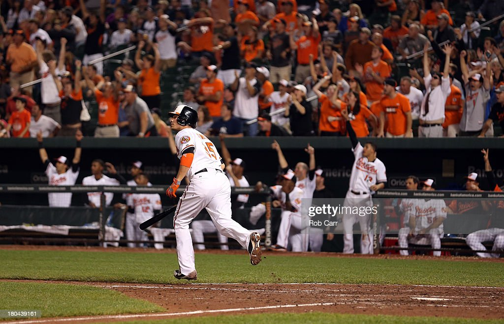 <a gi-track='captionPersonalityLinkClicked' href=/galleries/search?phrase=Danny+Valencia&family=editorial&specificpeople=5443820 ng-click='$event.stopPropagation()'>Danny Valencia</a> #35 of the Baltimore Orioles follows his three RBI home run against the New York Yankees during the eighth inning of the Orioles 6-5 loss at Oriole Park at Camden Yards on September 12, 2013 in Baltimore, Maryland.