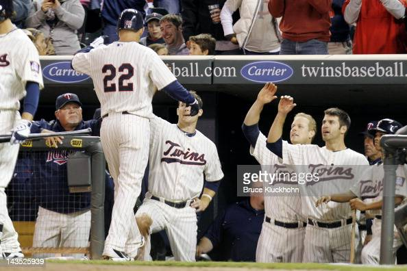 Danny Valencia of the Minnesota Twins celebrates his home run against the Boston Red Sox with Ron Gardenhire Josh Willingham Justin Morneau and Joe...
