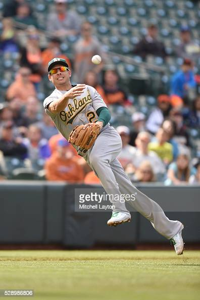 Danny Valencia of the Oakland Athletics fields a ground ball in the eighth inning during game one of a double header baseball game against the...