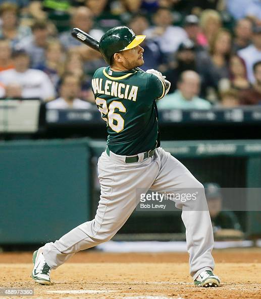 Danny Valencia of the Oakland Athletics hits a home run in the eighth inning against the Houston Astros at Minute Maid Park on September 18 2015 in...