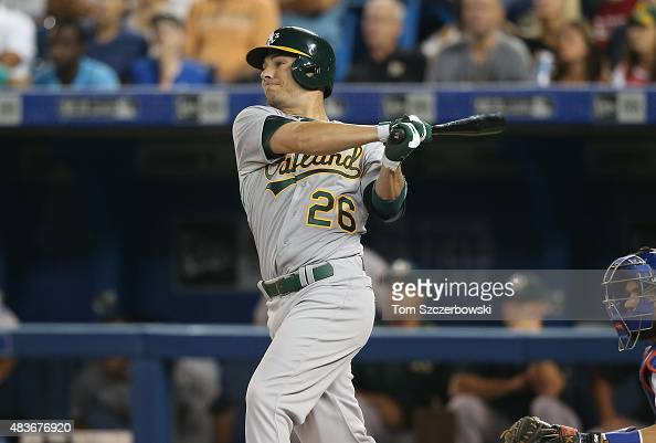 Danny Valencia of the Oakland Athletics hits an RBI double in the first inning during MLB game action against the Toronto Blue Jays on August 11 2015...