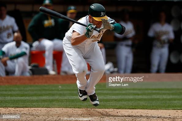 Danny Valencia of the Oakland Athletics leaps to avoid a pitch during the eighth inning against the New York Yankees at Oco Coliseum on May 22 2016...