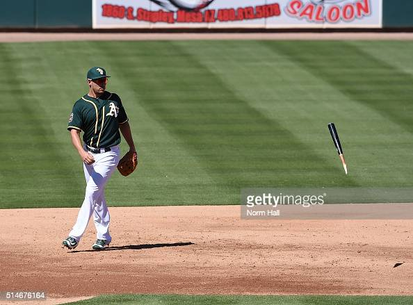 Danny Valencia of the Oakland Athletics watches a broken ball bounce past third base during the third inning against the Los Angeles Dodgers at...