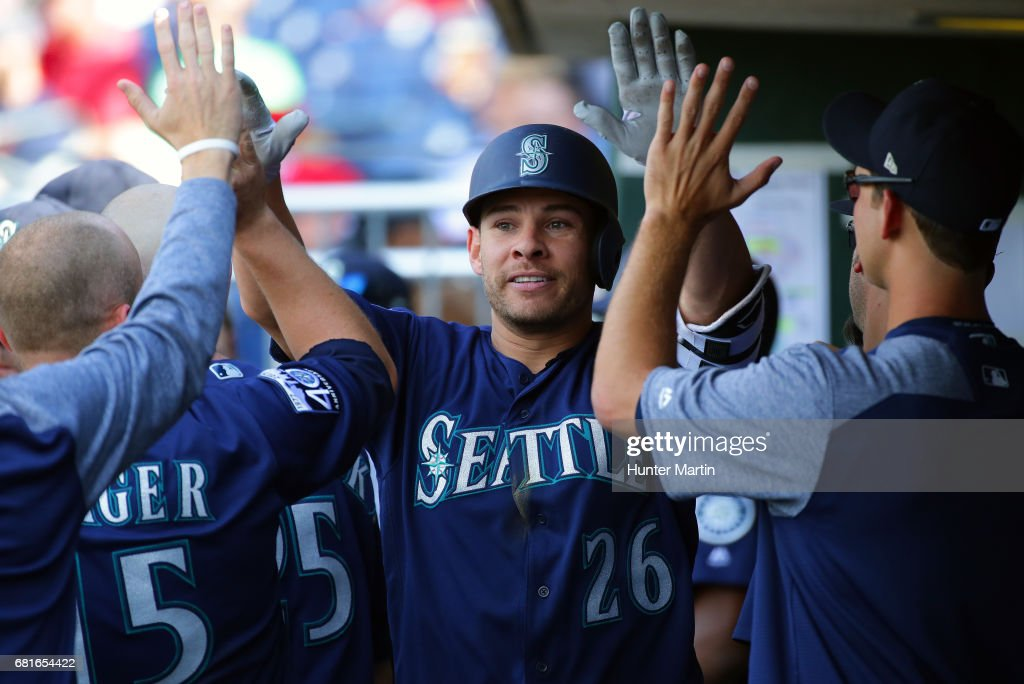 Danny Valencia #26 of the Seattle Mariners is congratulated by teammates in the dugout after hitting a solo home run in the eighth inning during a game against the Philadelphia Phillies at Citizens Bank Park on May 10, 2017 in Philadelphia, Pennsylvania. The Mariners won 11-6.