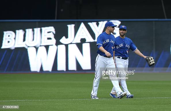 Danny Valencia of the Toronto Blue Jays celebrates their victory with Kevin Pillar during MLB game action against the Los Angeles Angels of Anaheim...