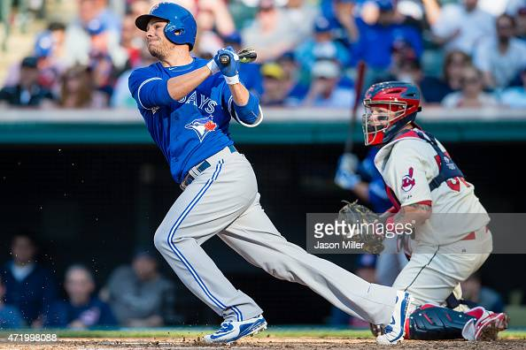 Danny Valencia of the Toronto Blue Jays hits an RBI ground ball during the sixth inning against the Cleveland Indians at Progressive Field on May 2...