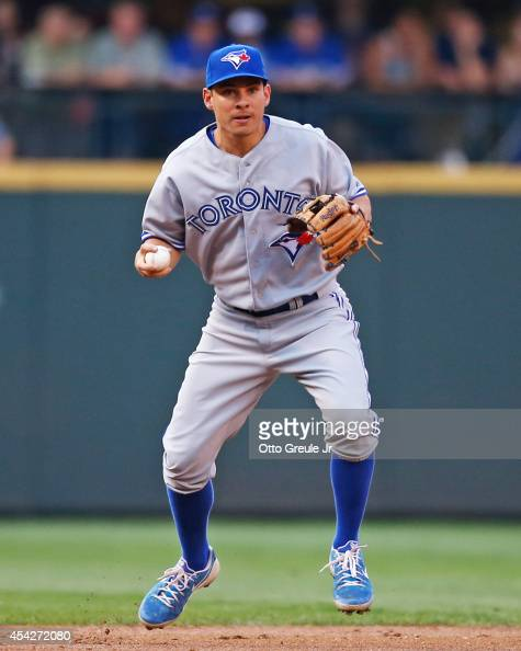 Danny Valencia of the Toronto Blue Jays readies to throw to first base on a groundout play against the Seattle Mariners at Safeco Field on August 11...