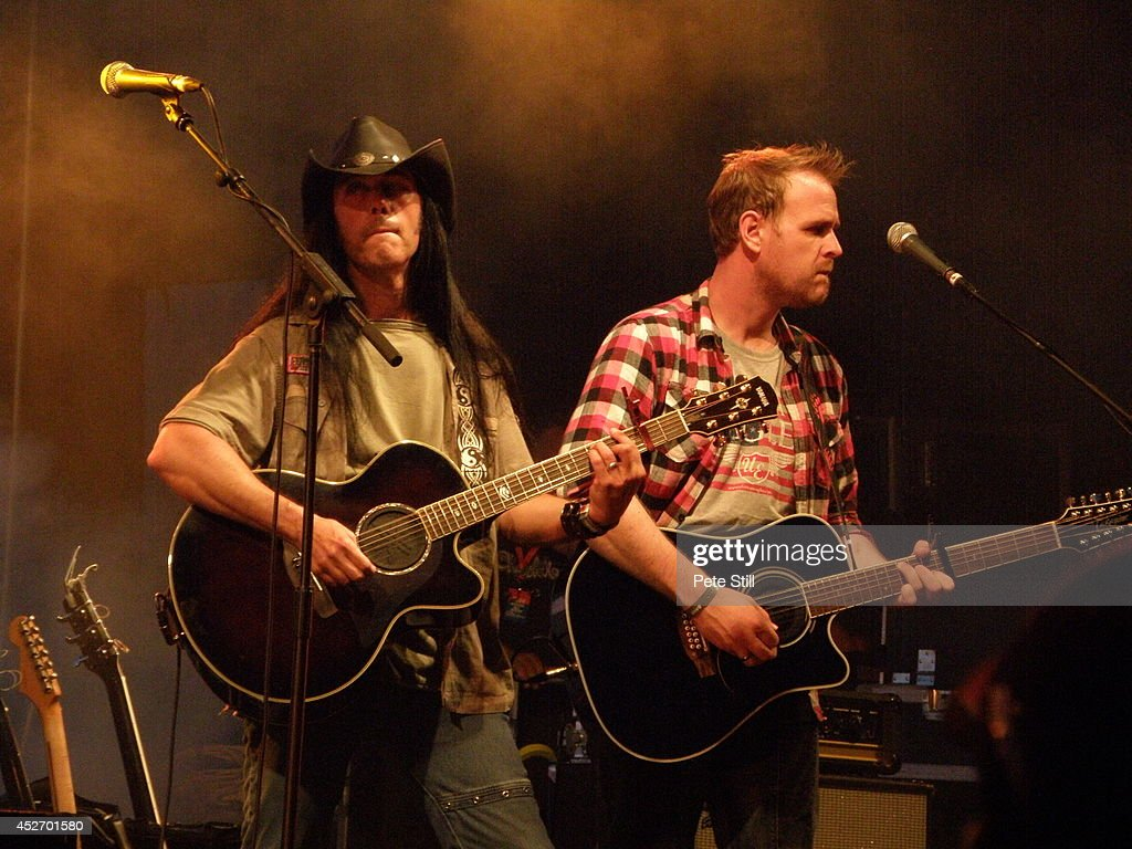 Danny Vaughn and Michael Lawrence of The Eagles tribute band Ultimate Eagles perform on stage at Silverstone Classic at Silverstone on July 25, 2014 in Northampton, United Kingdom.