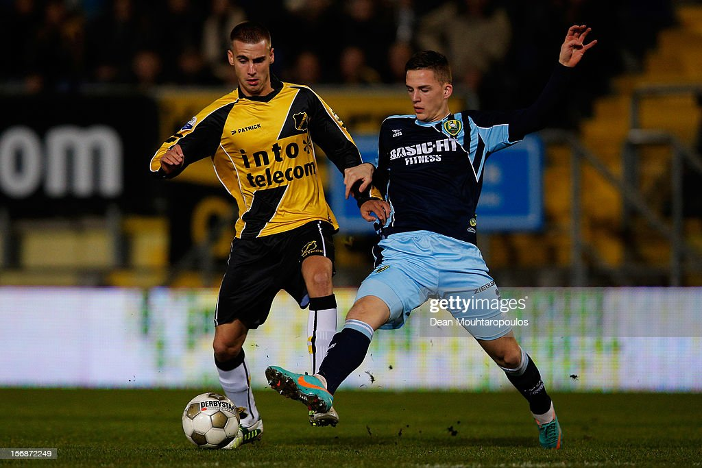 Danny Verbeek (yellow) of NAC and Kevin Jansen of Den Haag battle for the ball during the Eredivisie match between NAC Breda and ADO Den Haag at the Rat Verlegh Stadium on November 23, 2012 in Breda, Netherlands.