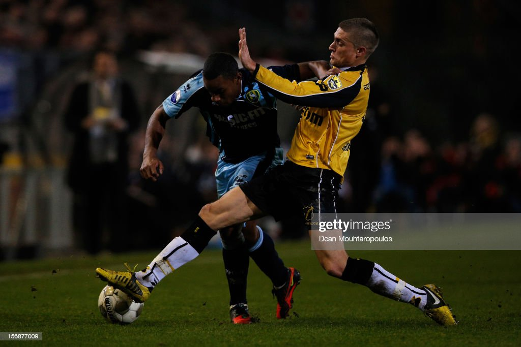 Danny Verbeek (yellow) of NAC and Rydell Poepon of Den Haag battle for the ball during the Eredivisie match between NAC Breda and ADO Den Haag at the Rat Verlegh Stadium on November 23, 2012 in Breda, Netherlands.