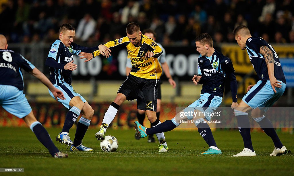 Danny Verbeek (yellow) of NAC attempts to beat the Den Haag defenders during the Eredivisie match between NAC Breda and ADO Den Haag at the Rat Verlegh Stadium on November 23, 2012 in Breda, Netherlands.