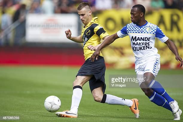 Danny Verbeek of NAC Breda Romeo Castelen of RKC Waalwijk during the Dutch Eredivisie match between NAC Breda and RKC Waalwijk at Rat Verlegh stadium...