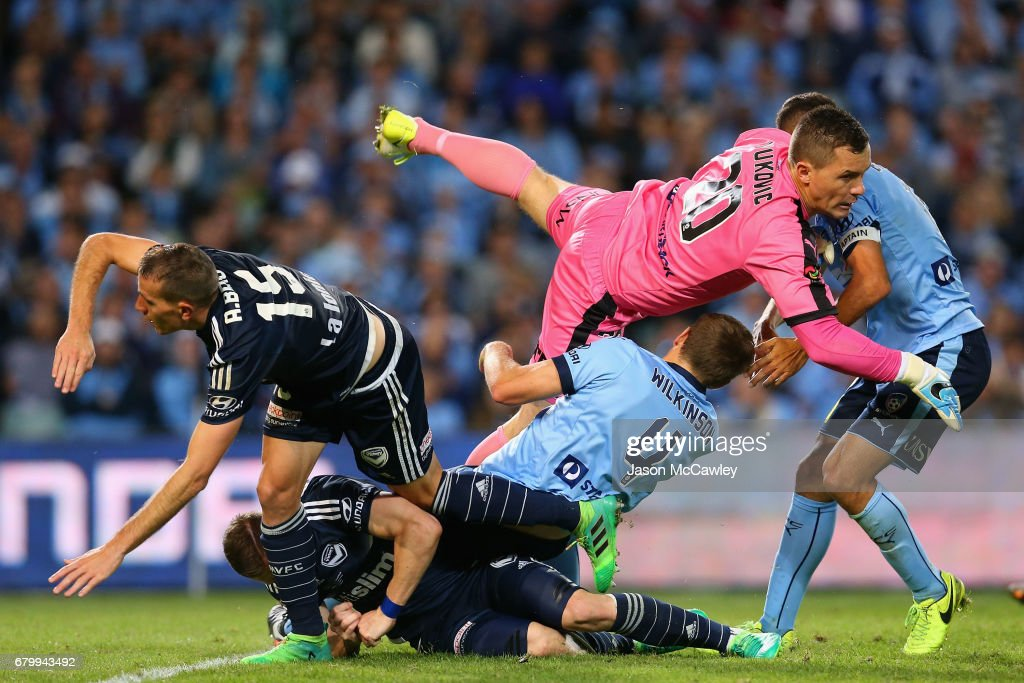 Danny Vukovic of Sydney colides with Alex Wilkinson of Sydney during the 2017 A-League Grand Final match between Sydney FC and the Melbourne Victory at Allianz Stadium on May 7, 2017 in Sydney, Australia.