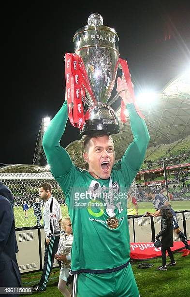 Danny Vukovic of the Victory celebrates after being presented with the FFA Cup after winning the FFA Cup Final match between Melbourne Victory and...
