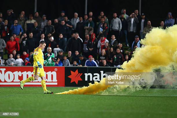 Danny Vukovic of the Victory kicks away a smoke flame thrown onto the ptich during the FFA Cup Round of 16 match between Rockdale City Suns and...