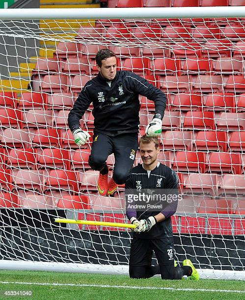 Danny Ward and Simon Mignolet of Liverpool in action during a training session at Anfield on August 8 2014 in Liverpool England