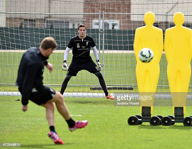 Danny Ward and Steven Gerrard of Liverpool during a training session at Melwood Training Ground on May 8 2015 in Liverpool England