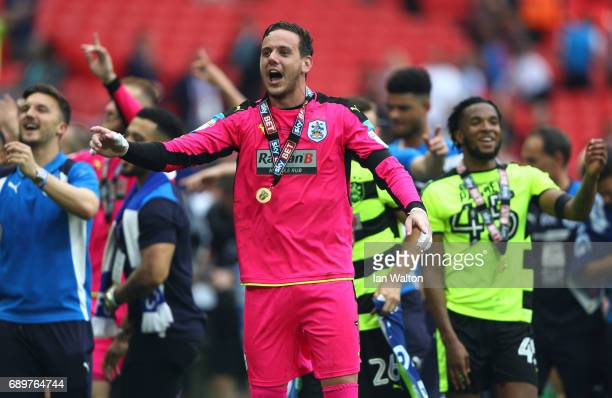 Danny Ward of Huddersfield Town celebrates promotion to the Premier League after the Sky Bet Championship play off final between Huddersfield and...