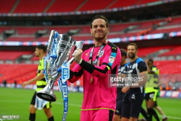 Danny Ward of Huddersfield Town celebrates with the trophy after the Sky Bet Championship Play Off Final match between Reading and Huddersfield Town...