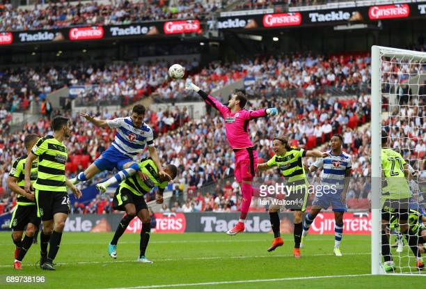 Danny Ward of Huddersfield Town punches the ball away during the Sky Bet Championship play off final between Huddersfield and Reading at Wembley...