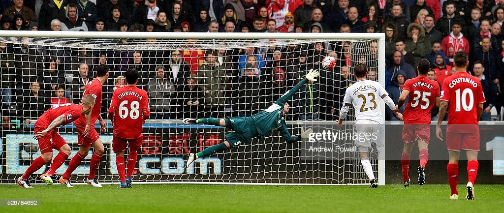 Danny Ward of Liverpool cant save the shot off Jack Cork of Swansea City who scores the second for Swansea City during a Premier League match between Swansea City and Liverpool at the Liberty Stadium on May 01, 2016 in Swansea, Wales.