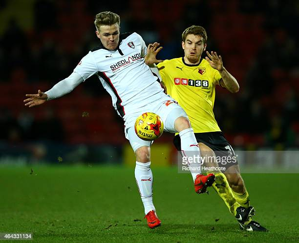 Danny Ward of Rotherham United battles for the ball with Tommie Hoban of Watford during the Sky Bet Championship match between Watford and Rotherham...
