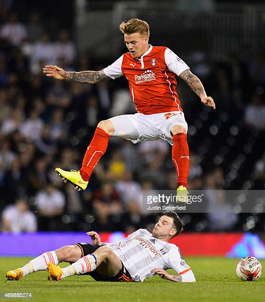 Danny Ward of Rotherham United jumps a tackle from Danny Guthrie of Fulham during the Sky Bet Championship match between Fulham and Rotherham United...