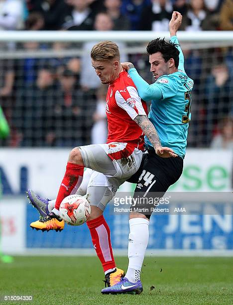 Danny Ward of Rotherham United tangles with George Thorne of Derby County during the Sky Bet Championship match between Rotherham United and Derby...