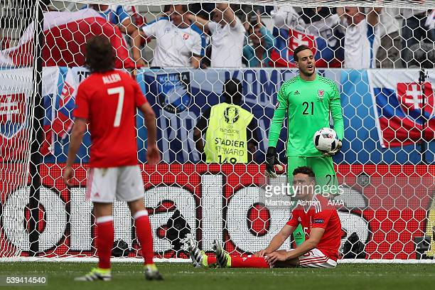 Danny Ward of Wales and his teammates react after conceding a goal to make the score 11 during the UEFA EURO 2016 Group B match between Wales and...