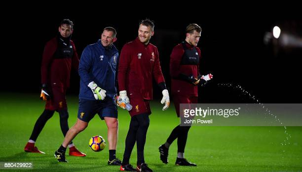 Danny Ward Simon Mignolet and Loris Karius of Liverpool with John Achterberg goal keeper coach during a training session at Melwood Training Ground...