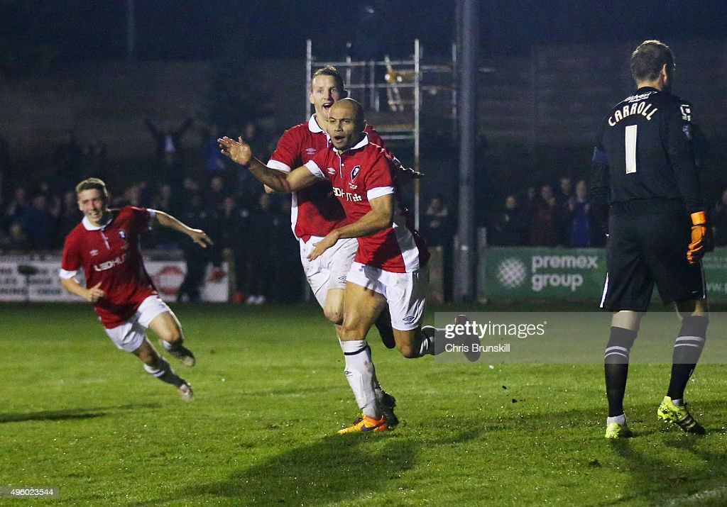Danny Webber of Salford City (2R) celebrates as he scores their first goal as goalkeeper Roy Carroll of Notts County looks dejected during the Emirates FA Cup first round match between Salford City and Notts County at Moor Lane on November 6, 2015 in Salford, England.