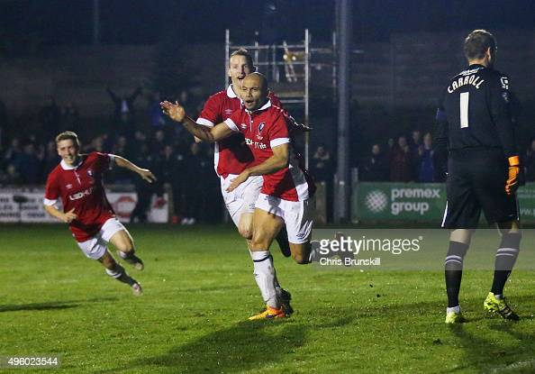 Danny Webber of Salford City celebrates as he scores their first goal as goalkeeper Roy Carroll of Notts County looks dejected during the Emirates FA...
