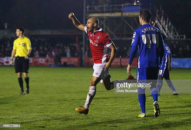 Danny Webber of Salford City celebrates as he scores their first goal as Alan Sheehan of Notts County looks dejected during the Emirates FA Cup first...
