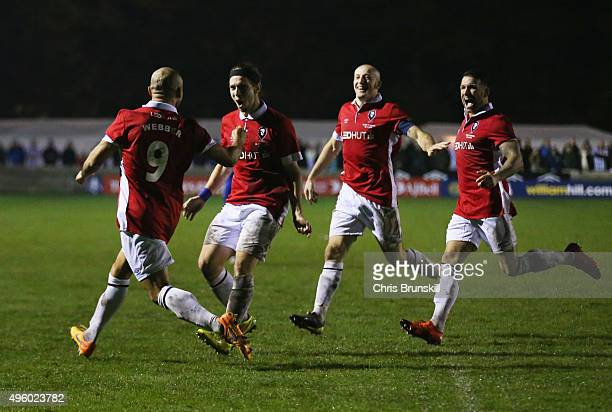 Danny Webber of Salford City celebrates with team mates as he scores their first goal during the Emirates FA Cup first round match between Salford...