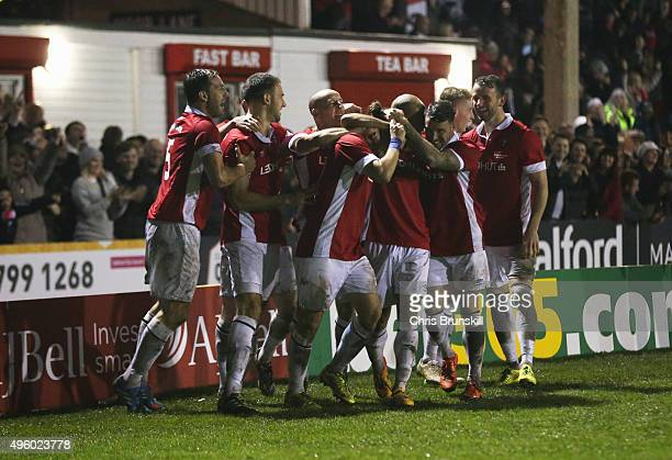 Danny Webber of Salford City is mobbed by team mates in celebration as he scores their first goal during the Emirates FA Cup first round match...